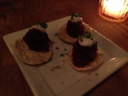 Cracker with beet puree and creme fraiche