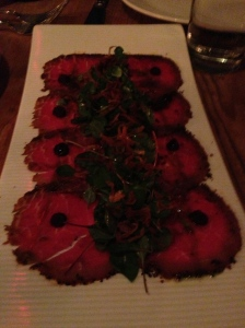 Smoked Pepper Crusted Beef Carpaccio-housemade beef marinated in hearts of fire